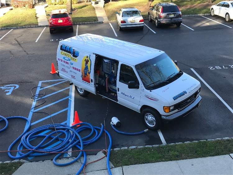 Carpet cleaning van and machine